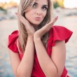 Beautiful, young woman sends an air kiss — Stockfoto