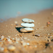 Stack of stones on the sea beach — Stock Photo