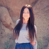 Beautiful brunette woman on the beach — Stock Photo