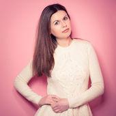 Beautiful, young woman poses in studio — Stock Photo
