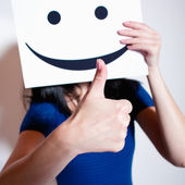 Woman showing thumbs up — Stockfoto