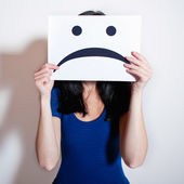 Holding a blank paper with sad face — Stockfoto
