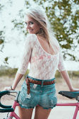 Beautiful girl hipster bike — Stock Photo