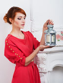 Girl with a lamp shines the room — Stock Photo