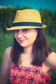 Young sexy summer girl wearing a hat — Stock Photo