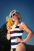Sexy girl with a summer cocktail — Stock Photo