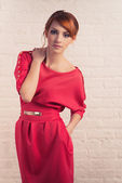 Fashionable woman posing in red dres — Photo