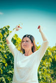 Woman  walks on a vineyard — Stock Photo
