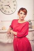 Fashionable woman posing in red dress — Photo