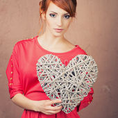 Woman hold Valentine day symbol. — Stock Photo
