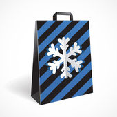 Festive black striped paper-bag with cut out snowflake — Stock Vector