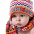 Portrait of  smiling baby in knitted hat and scarf — Stock Photo
