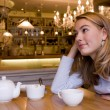 Smiling young woman in cafe — Stock Photo