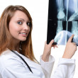 Female doctor looking at X-ray image - Stock Photo