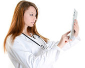 Female student doctor working with digital tablet — Stock Photo