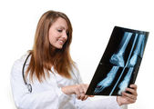 Female doctor looking at X-ray image — Stock Photo