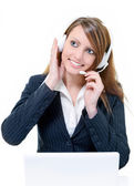 Smiling attractive call center agent — Stock Photo