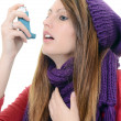 Woman with asthma using an asthma inhaler — Stock Photo #19431371