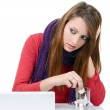 Woman taking pills holding a glass of water in office — Stock Photo #19432801