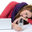 Woman taking pills holding a glass of water in office — Stock Photo #19432811