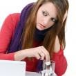 Woman taking pills holding a glass of water in office — Stock Photo #19432831