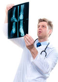 Cheerful doctor examining feet x-ray — Stock Photo