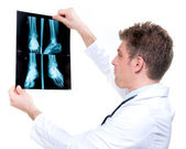 Attractive and expressive doctor holding x-ray — Stock Photo
