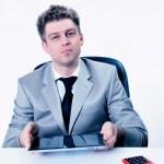 Handsome businessman portrait using his digital tablet — Stock Photo #20098931