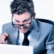 Stressed crazy manager at work - Stock Photo