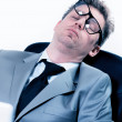Tired funny businessman at the office — Stock Photo