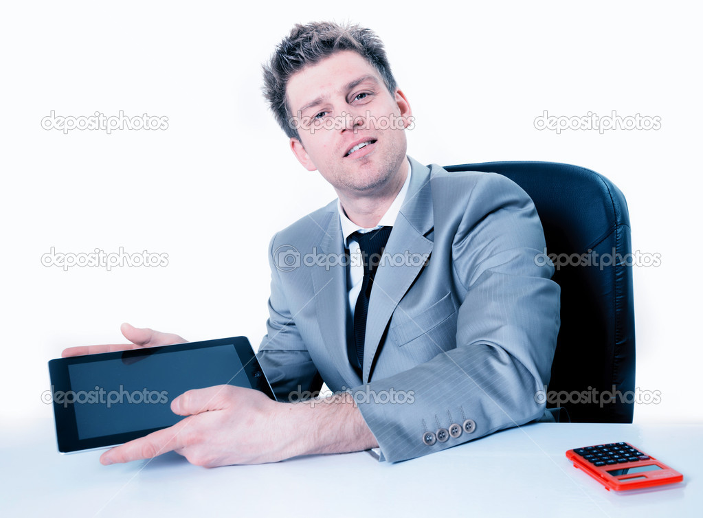 Handsome businessman showing something in a digital tablet  Stock Photo #20099621