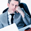 Stock Photo: Tired businessmat office