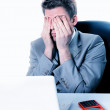 Thoughtful or stressful businessman at work — Stock Photo #20101297