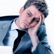 Exhausted businessman at the office — Stockfoto