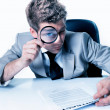 Royalty-Free Stock Photo: Handsome businessman with magnifying glass study  contract