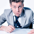 Stock Photo: Portrait of handsome businessmlooking at contract