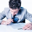 businessman with magnifying glass analyze contract — Stock Photo
