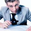 Stock Photo: Expressive businessmwith magnifying glass study contract