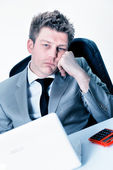 Tired businessman at the office — Stock Photo