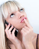 Pretty blond girl pondering while phoning — Stock Photo