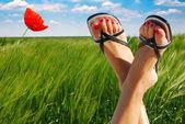 Ecological feet crossed symbolizing wellbeing — Stock Photo