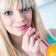 Cute girl drinking an orange from a straw — Stock Photo