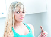 Cute girl with chocolate bar in her hand — Stock Photo