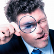 Stock Photo: Businessmwith magnifying glass