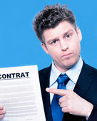 Businessman pointing to a contract — Stock Photo