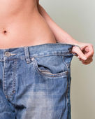 Close-up of woman belly in a too big pants — Stock Photo