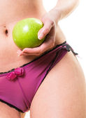 Young girl with perfect body and apple in hand — Stock Photo