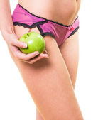 Woman with perfect legs and apple in hand — Stock Photo