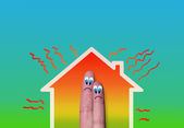 House with high heat loss illustration and couple of fingers — Stock Photo
