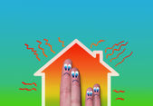 House with high heat loss and fingers family — Stock Photo